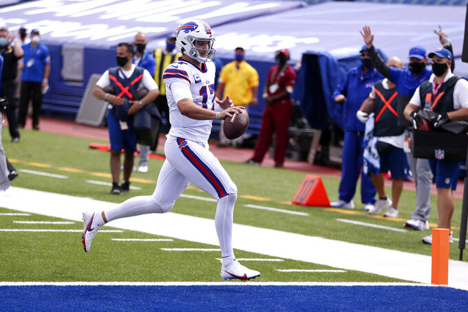 Buffalo Bills quarterback Josh Allen (17) scrambles for a touchdown during the first half of an NFL football game against the New York Jets in Orchard Park, N.Y., Sunday, Sept. 13, 2020. (AP Photo/Jeffrey T. Barnes)