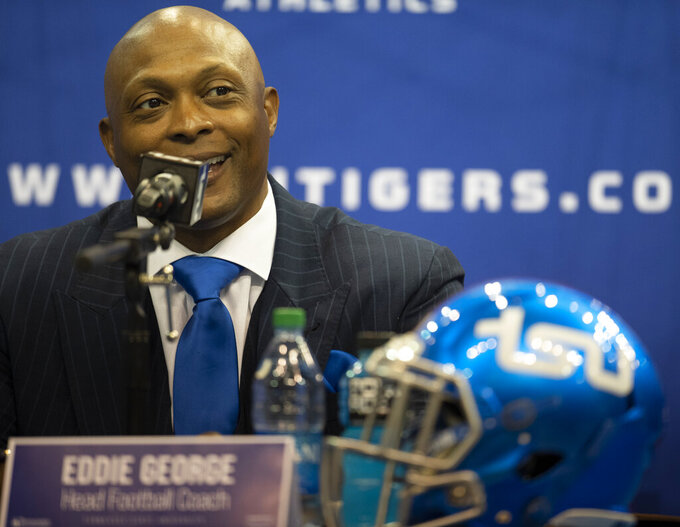 FILE - In this April 13, 2021, file photo, New Tennessee State University NCAA college football coach Eddie George smiles during a news conference in Nashville, Tenn.. George is one of several high-profile former pro athletes to take on athletic programs at black colleges and universities at a time when the country seems more than ready. (George Walker/The Tennessean via AP, File)