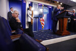 Dr. Anthony Fauci, director of the National Institute of Allergy and Infectious Diseases, left, listens as President Donald Trump speaks during a coronavirus task force briefing at the White House, Sunday, April 5, 2020, in Washington. From left, Fauci, Dr. Deborah Birx, White House coronavirus response coordinator, Trump and Vice President Mike Pence. (AP Photo/Patrick Semansky)