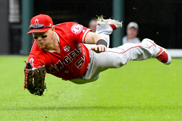 File-This Sept. 8, 2019, file photo shows Los Angeles Angels right fielder Kole Calhoun (56) catching a ball hit by Chicago White Sox's James McCann during the seventh inning of a baseball game in Chicago. The Arizona Diamondbacks announced Monday, Dec. 30, 2019, that they have signed Calhoun to a two-year contract with a club option for 2022. The 32-year-old Calhoun, who lives in nearby Tempe, Arizona, has played eight major league seasons with the Los Angeles Angels, batting .249 in his career with 140 homers. In 2019, he hit .232 with a career-high 33 homers while playing mostly right field. (AP Photo/Matt Marton,File)