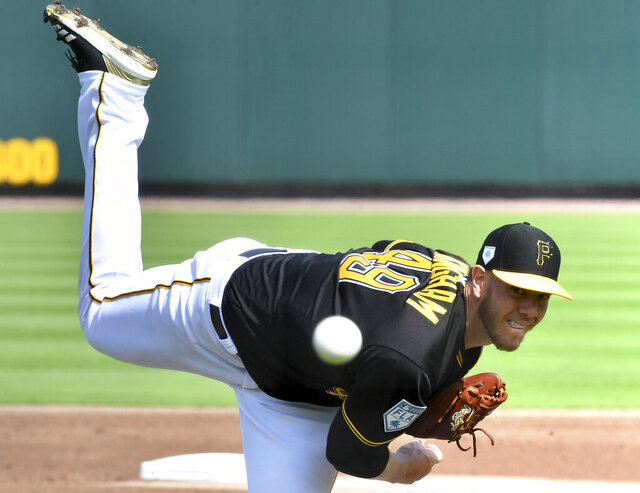 In this Feb. 24, 2019 photo, Pittsburgh Pirates pitcher Nick Kingham throws during spring training baseball in Bradenton, Fla. After signing with the Korea Baseball Organization's SK Wyverns in November, Kingham has found success on the other side of the world and will actually take the mound for the start of the KBO season on Tuesday. (Matt Freed/Pittsburgh Post-Gazette via AP)