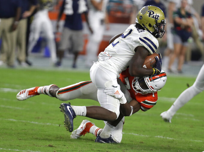 Pittsburgh wide receiver Maurice Ffrench (2) is tackled by Miami defensive back Al Blades Jr. during the second half of an NCAA college football game, Saturday, Nov. 24, 2018, in Miami Gardens, Fla. Miami won 24-3. (AP Photo/Lynne Sladky)