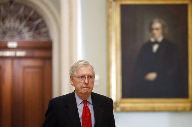 Senate Majority Leader Mitch McConnell of Ky., walks to his office on Capitol Hill in Washington, Thursday, April 9, 2020. Senate Democrats on Thursday stalled President Donald Trump's request for $250 billion to supplement a