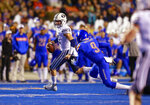 BYU quarterback Zach Wilson (11) scrambles away from Boise State linebacker Desmond Williams (9) during the first half of an NCAA college football game Saturday, Nov. 3, 2018, in Boise, Idaho. (AP Photo/Steve Conner)