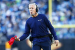 Seattle Seahawks head coach Pete Carroll tosses the red flag to challenge a play during the second half of an NFL football game against the Carolina Panthers in Charlotte, N.C., Sunday, Dec. 15, 2019. (AP Photo/Brian Blanco)