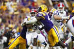 FILE - In this Sept. 22, 2016, file photo, LSU linebacker Devin White (40) stops Louisiana Tech running back Jaqwis Dancy (23) in the first half of a game in Baton Rouge, La. White was named to the 2018 AP All-America NCAA college football team, Monday, Dec. 10, 2018. (AP Photo/Tyler Kaufman, File)