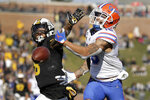Florida wide receiver Freddie Swain, right, is unable to catch a pass as Missouri safety Joshuah Bledsoe defends during the first half of an NCAA college football game Saturday, Nov. 16, 2019, in Columbia, Mo. (AP Photo/Jeff Roberson)