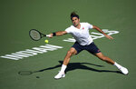 Roger Federer, of Switzerland, reaches to hit a forehand to Kyle Edmund, of Britain, at the BNP Paribas Open tennis tournament Wednesday, March 13, 2019, in Indian Wells, Calif. (AP Photo/Mark J. Terrill)