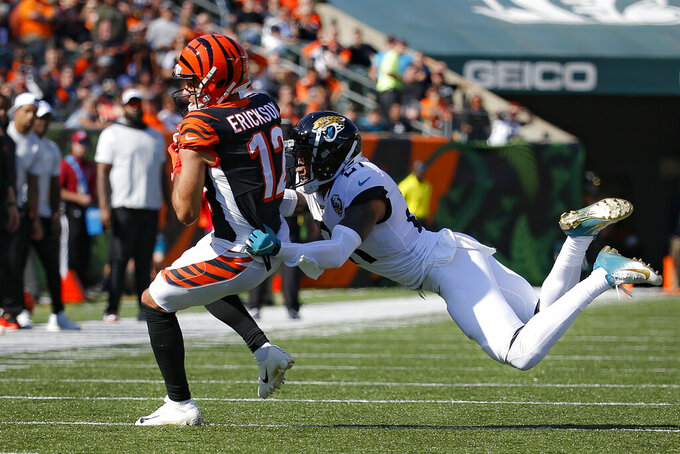 Cincinnati Bengals wide receiver Alex Erickson (12) breaks away from Jacksonville Jaguars cornerback A.J. Bouye (21) in the first half of an NFL football game, Sunday, Oct. 20, 2019, in Cincinnati. (AP Photo/Frank Victores)