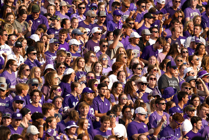 Students cheer before an NCAA college football game between Kansas State and Southern Illinois, Saturday, Sept. 11, 2021, in Manhattan, Kan.(AP Photo/Charlie Riedel)