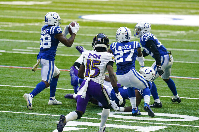 Indianapolis Colts inside linebacker Bobby Okereke (58) picks up a fumble by the Baltimore Ravens in the second half of an NFL football game in Indianapolis, Sunday, Nov. 8, 2020. (AP Photo/Darron Cummings)