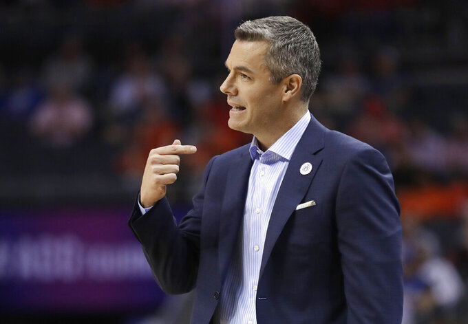 Virginia head coach Tony Bennett directs his team against North Carolina State during the first half of an NCAA college basketball game in the Atlantic Coast Conference tournament in Charlotte, N.C., Thursday, March 14, 2019. (AP Photo/Nell Redmond)