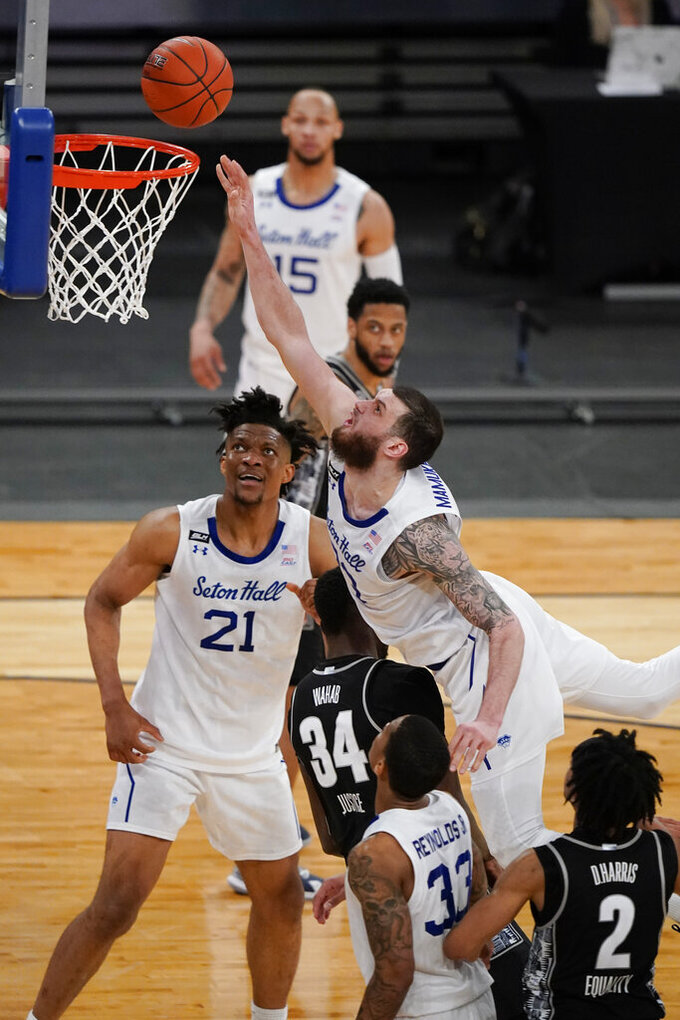 Seton Hall's Sandro Mamukelashvili, right, shoots over Georgetown's Qudus Wahab (34) during the second half of an NCAA college basketball game in the semifinals in the Big East men's tournament Friday, March 12, 2021, in New York. (AP Photo/Frank Franklin II)
