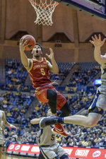 Iowa State guard Lindell Wigginton (5) goes to the basket during the second half of an NCAA college basketball game against West Virginia, Wednesday, March 6, 2019, in Morgantown, W.Va. (William Wotring/The Dominion-Post via AP)