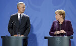 German Chancellor Angela Merkel, right, and NATO Secretary General Jens Stoltenberg, left, address the media during a press conference at the Chancellery in Berlin, Germany, Thursday, Nov. 7, 2019. (AP Photo/Michael Sohn)