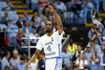 North Carolina guard Brandon Robinson (4) reacts following a basket against Miami during the first half of an NCAA college basketball game in Chapel Hill, N.C., Saturday, Jan. 25, 2020. (AP Photo/Gerry Broome)