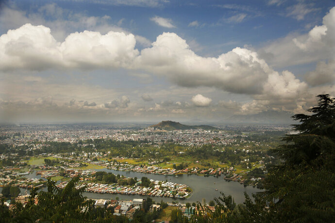 An overview of the Dal Lake in Srinagar, Indian controlled Kashmir, Oct. 1, 2019. Indian-controlled Kashmir's economy is yet to recover from a colossal loss a year after New Delhi scrapped the disputed region's autonomous status and divided it into two federally governed territories. (AP Photo/Mukhtar Khan)