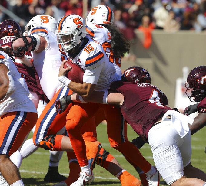Syracuse quarterback Garrett Shrader (16) is tackled by Virginia Tech linebacker Dax Hollifield (4) during the first half of of an NCAA college football game in Blacksburg Va., Saturday, Oct. 23 2021. (Matt Gentry/The Roanoke Times via AP)