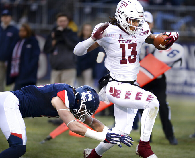 Temple wide receiver Isaiah Wright (13) scores the first touchdown of the first half of an NCAA college football game against Connecticut, Saturday, Nov. 24, 2018, in East Hartford, Conn. (AP Photo/Stephen Dunn)