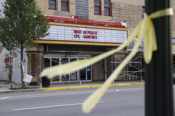 """The State Theatre marquee reads """"Rest In Peace Cpl. Sanchez"""" for Marine Cpl. Humberto Sanchez, Monday, Sept. 13, 2021 in Logansport, Ind. Sanchez was one of 13 U.S. service members to die in an explosion during evacuation efforts in Afghanistan. (Nikos Frazier/Journal & Courier via AP)"""