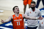 Syracuse's Joseph Girard III celebrates as he leaves the court following a second-round game against West Virginia in the NCAA men's college basketball tournament at Bankers Life Fieldhouse, Sunday, March 21, 2021, in Indianapolis. Syracuse defeated Syracuse 75-72. (AP Photo/Darron Cummings)