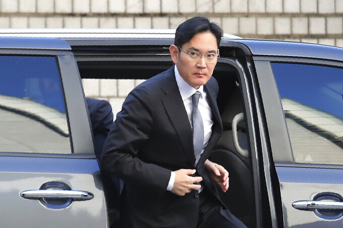 FILE - In this Nov. 22, 2019, file photo, Samsung Electronics Vice Chairman Lee Jae-yong gets out of a car at the Seoul High Court in Seoul, South Korea. In an announcement by Seoul's Justice Ministry on Monday, Aug. 9, 2021, South Korea will release billionaire Lee on parole this week after he spent 18 months in prison for his role in a massive corruption scandal that triggered nationwide protests and ousted the country's previous president. (AP Photo/Ahn Young-joon, File)