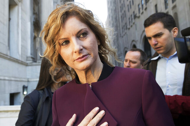 FILE - In this Oct. 18, 2018, file photo, Summer Zervos leaves New York state appellate court in New York. Zervos' lawsuit over President Donald Trump's response to her sexual assault allegations was put on hold Tuesday, Jan. 7, 2020, when a court froze the case until New York's top court weighs whether to dismiss the case or delay it through his presidency.  (AP Photo/Mary Altaffer, File)