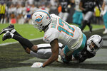 Las Vegas Raiders cornerback Casey Hayward (29) tackles Miami Dolphins wide receiver Jaylen Waddle (17) for a safety during the first half of an NFL football game, Sunday, Sept. 26, 2021, in Las Vegas. (AP Photo/David Becker)