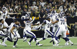 Los Angeles Rams players celebrate after overtime of the NFL football NFC championship game against the New Orleans Saints, Sunday, Jan. 20, 2019, in New Orleans. (AP Photo/David J. Phillip)