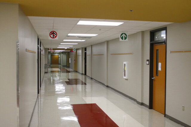 Hallways are empty at Clarke Central High School that would normally be packed with students heading to class in Athens, Ga., on Thursday, Sept. 24, 2020. Due to the ongoing COVID-19 pandemic Athens-Clarke County Schools are doing distance learning this fall. (Joshua L. Jones/Athens Banner-Herald via AP)