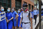 Students wearing mask hold hands to surround the St. Stephen's Girls' College in Hong Kong, Monday, Sept. 9, 2019. Thousands of demonstrators in Hong Kong urged President Donald Trump to