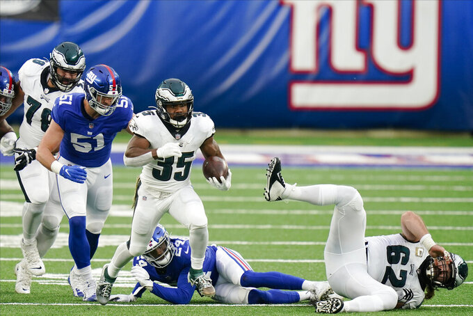 Philadelphia Eagles' Boston Scott (35) runs for a touchdown as New York Giants' Kyler Fackrell (51) chases him during the second half of an NFL football game Sunday, Nov. 15, 2020, in East Rutherford, N.J. (AP Photo/Seth Wenig)