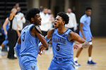 Villanova's Brandon Slater, left, and Justin Moore react after a basket during the first half of an NCAA college basketball game against St. John's, Tuesday, Feb. 23, 2021, in Villanova, Pa. (AP Photo/Matt Slocum)