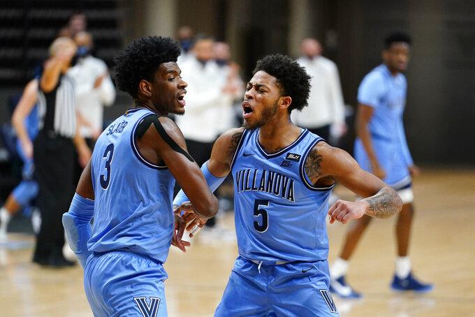 Villanova's Brandon Slater, left, and Justin Moore react after a basket during the first half of an NCAA college basketball game against St. John's, Tuesday, Feb. 23, 2021, in Villanova, Pa. (AP Photo/Matt Slocum)