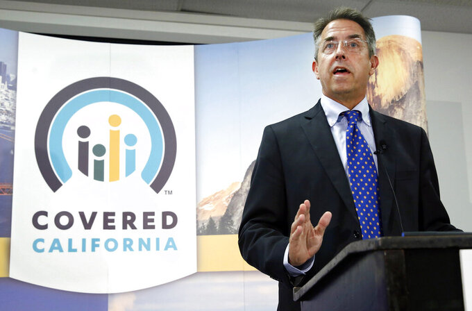 FILE - In this Nov. 13, 2013, file photo, Peter Lee, executive director of Covered California, the state's health insurance exchange, talks at a news conference in Sacramento, Calif. Individual insurance premiums on California's health exchange for the uninsured will go up 1.8% on average next year, a low increase credited to record enrollment and increased competition among health carriers, officials announced Wednesday, July 28, 2021. The subsidies reduce costs for some people and make health insurance basically free for many others through 2022, said director Lee. (AP Photo/Rich Pedroncelli, File)