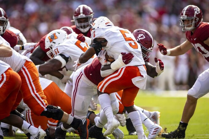 Alabama defensive lineman Byron Young (47) stops Mercer running back Fred Davis (5) behind the line during the first half of an NCAA college football game, Saturday, Sept. 11, 2021, in Tuscaloosa, Ala. (AP Photo/Vasha Hunt)
