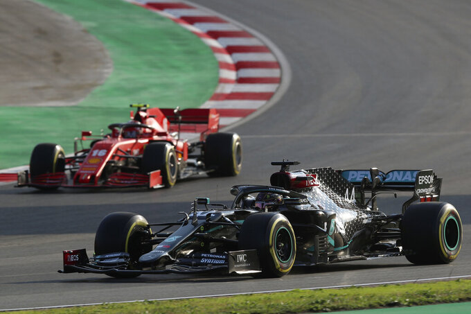 Mercedes driver Lewis Hamilton of Britain steers his car followed by Ferrari driver Charles Leclerc of Monaco, left, during a practice session at the Istanbul Park circuit racetrack in Istanbul, Friday, Nov. 13, 2020. The Formula One Turkish Grand Prix will take place on Sunday. (Tolga Bozoglu/Pool via AP)