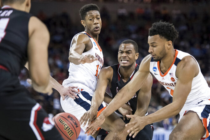 Gardner-Webb forward Eric Jamison Jr., center, attempts a pass between Virginia guard De'Andre Hunter (12) and Braxton Key, right, during a first-round game in the NCAA men's college basketball tournament Friday, March 22, 2019, in Columbia, S.C. Virginia defeated Gardner-Webb 71-56. (AP Photo/Sean Rayford)