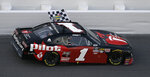 Michael Annett (1) drives with the checkered flag after winning the NASCAR Xfinity auto race Saturday, Feb. 16, 2019, at Daytona International Speedway in Daytona Beach, Fla. (AP Photo/Chris O'Meara)
