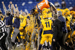 Kent State head coach Sean Lewis is doused at the end of the team's 51-41 win over Utah State in the Frisco Bowl NCAA college football game Friday, Dec. 20, 2019, in Frisco, Texas. (AP Photo/Brandon Wade)