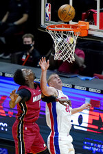 Miami Heat center Bam Adebayo, left, shoots over Detroit Pistons center Mason Plumlee (24) during the first half of an NBA basketball game, Saturday, Jan. 16, 2021, in Miami. (AP Photo/Lynne Sladky)