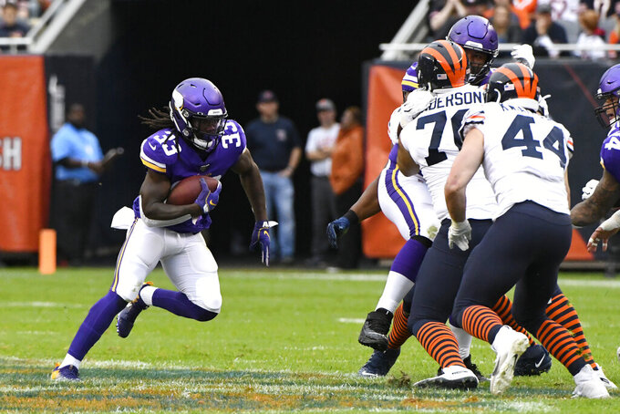 Minnesota Vikings running back Dalvin Cook runs with the ball during the half of an NFL football game against the Chicago Bears Sunday, Sept. 29, 2019, in Chicago. (AP Photo/Matt Marton)