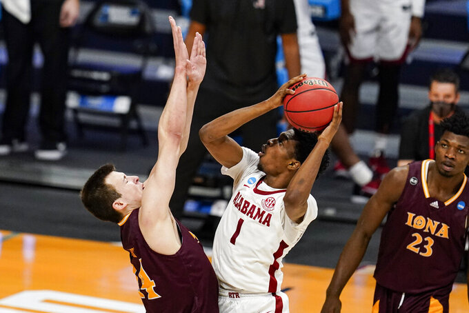 Alabama forward Herbert Jones (1) shoots over Iona forward Dylan van Eyck (24) in the second half of a first-round game in the NCAA men's college basketball tournament at Hinkle Fieldhouse in Indianapolis, Saturday, March 20, 2021. Alabama defeated Iona 68-55. (AP Photo/Michael Conroy)