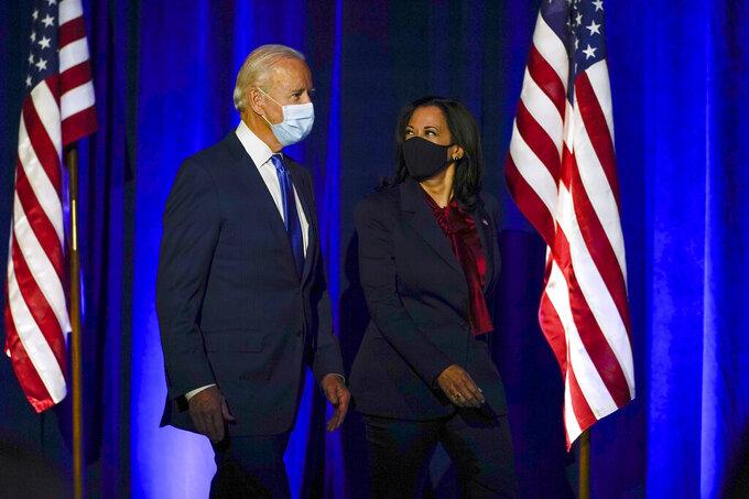 Democratic presidential candidate former Vice President Joe Biden arrives with his running mate Sen. Kamala Harris, D-Calif., to speak Friday, Nov. 6, 2020, in Wilmington, Del. (AP Photo/Carolyn Kaster)