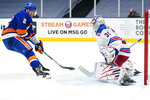 New York Rangers goaltender Igor Shesterkin (31) stops a shot on goal by New York Islanders' Nick Leddy (2) during the second period of an NHL hockey game Sunday, April 11, 2021, in Uniondale, N.Y. (AP Photo/Frank Franklin II)