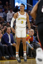Golden State Warriors guard Jordan Poole reacts after scoring against the Portland Trail Blazers during the first half of an NBA basketball game in San Francisco, Monday, Nov. 4, 2019. (AP Photo/Jeff Chiu)