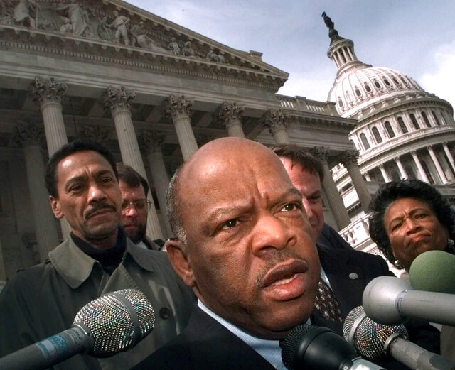 FILE - In this Friday, March 5, 1999, file photo, U.S. Rep. John Lewis, D-Ga., speaks with reporters in Washington. Lewis, who carried the struggle against racial discrimination from Southern battlegrounds of the 1960s to the halls of Congress, died Friday, July 17, 2020. (AP Photo/Khue Bui, File)
