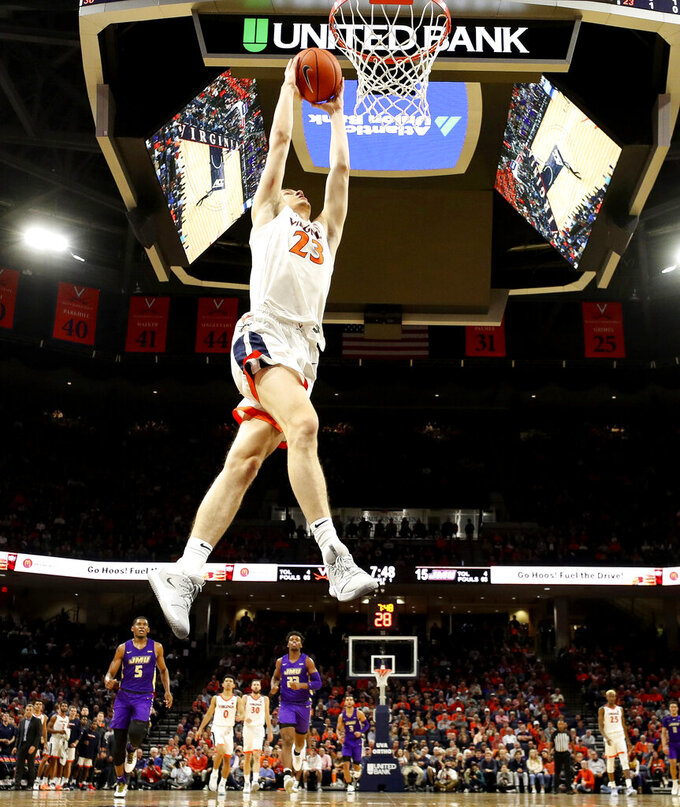 Virginia guard Kody Stattmann (23) prepares to dunk during an NCAA college basketball game against James Madison in Charlottesville, Va., Sunday, Nov. 10, 2019. (AP Photo/Andrew Shurtleff)
