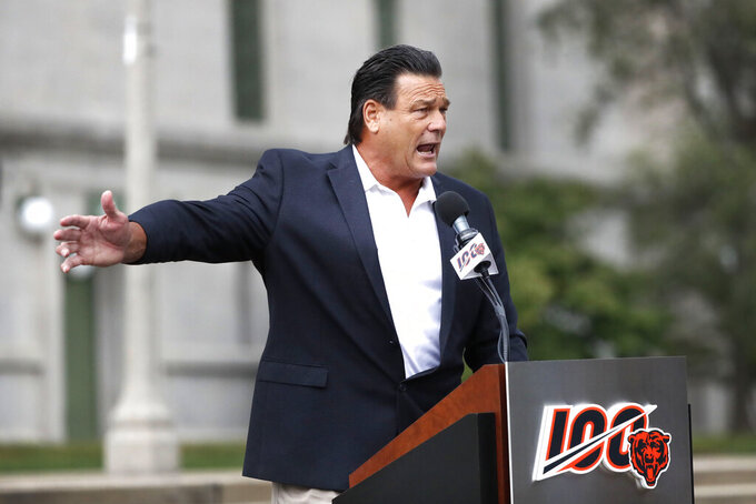 Former Chicago Bears and Pro Football Hall of Fame defensive tackle Dam Hampton, addresses the crowd during an unveiling ceremony outside Soldier Field of statues honoring George Halas and Walter Payton Tuesday, Sept. 3, 2019, in Chicago. (AP Photo/Charles Rex Arbogast)