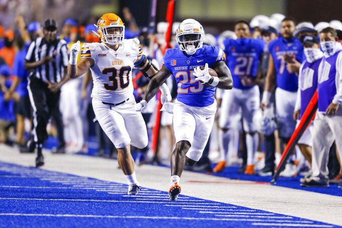 Boise State running back Taequan Tyler (25) breaks away from UTEP linebacker Cal Wallerstedt (30) during the second half of an NCAA college football game Friday, Sept. 10, 2021, in Boise, Idaho. (AP Photo/Steve Conner)